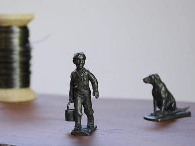 bronze boy and dog