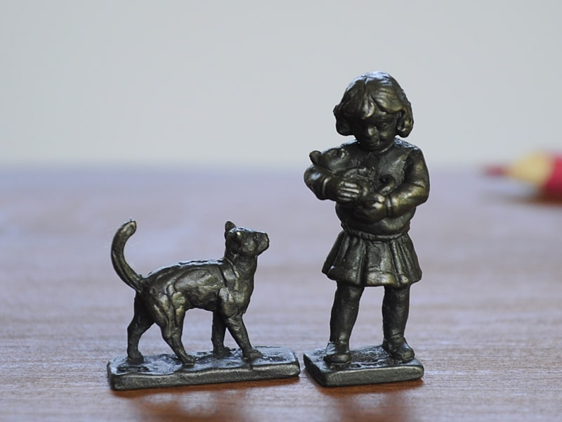 bronze girl and cat