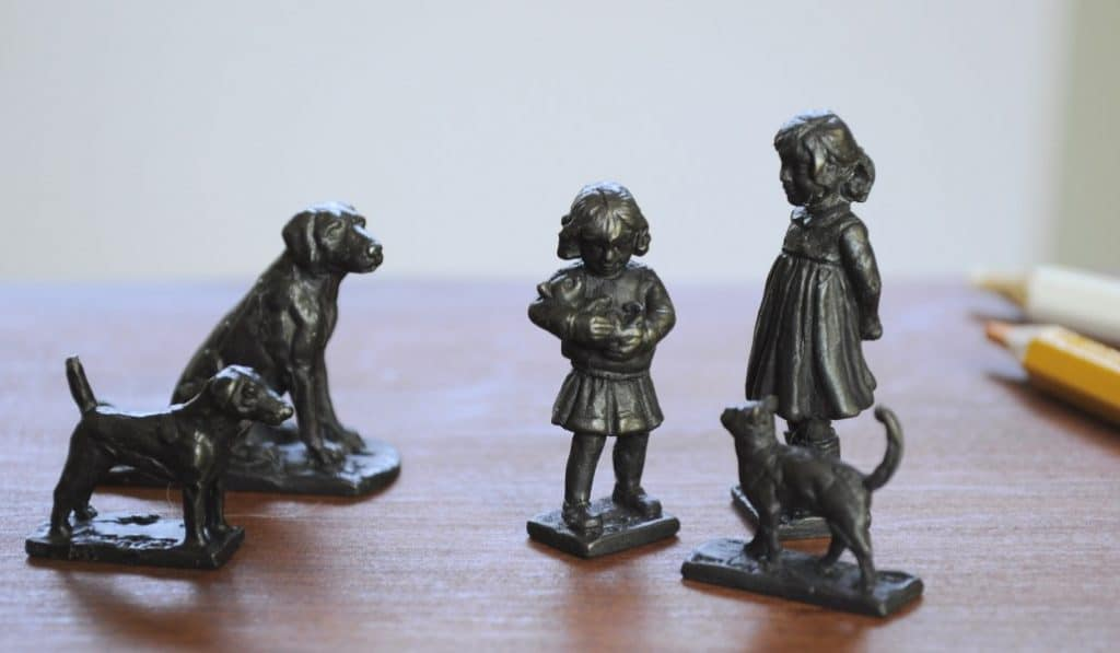 little bronze girl and animals